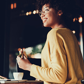 Woman eating a sandwich at a cafe